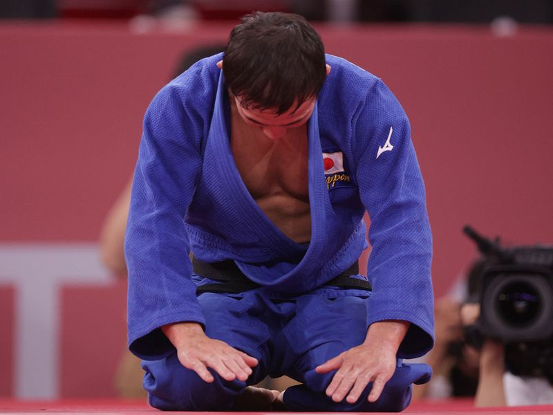 Naohisa Takato of Japan reacts after winning judo gold