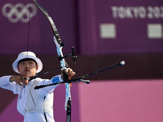 South Korea's An San competes in the mixed team event Yumenoshima Park Archery Field