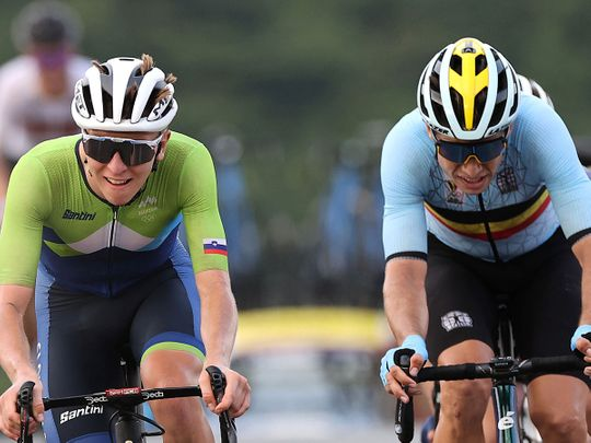 UAE Team Emirates' Tadej Pogacar of Slovenia and Wout van Aert of Belgium sprint for the line in the men's cycling road race at Tokyo 2020