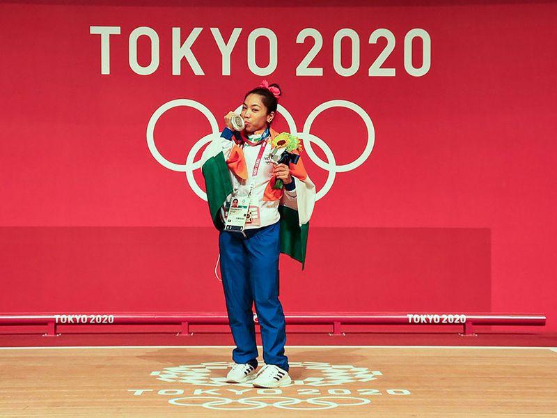 **EDS: TWITTER IMAGE POSTED BY @mirabai_chanu ON SATURDAY, JULY 24, 2021** Tokyo: Weightlifter Mirabai Chanu after winning silver medal at the T0kyo Olympics. (PTI Photo)(PTI07_24_2021_000278B)