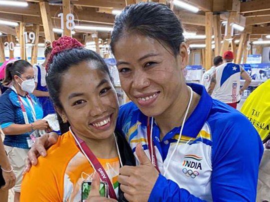 India's Mirabai Chanu with boxer Mary Kom