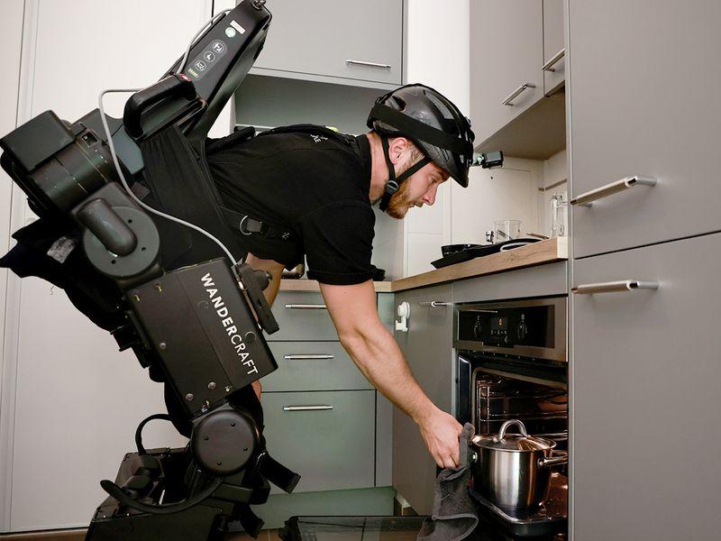 Kevin Piette demonstrates a robot exoskeleton