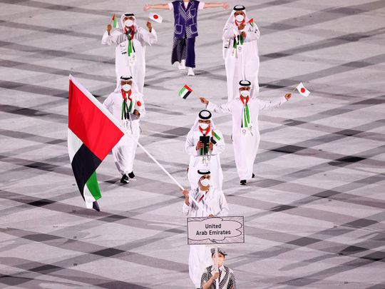 Yousuf Al Matrooshi carries the UAE flag at the Tokyo 2020 opening ceremony