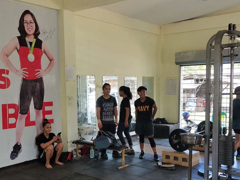 A portrait of weightlifter Hidilyn Diaz, the first athlete from the Philippines to win an Olympic gold medal, is seen at a gym where her junior team members train in Zamboanga City on the southern island of Mindanao in the Philippines