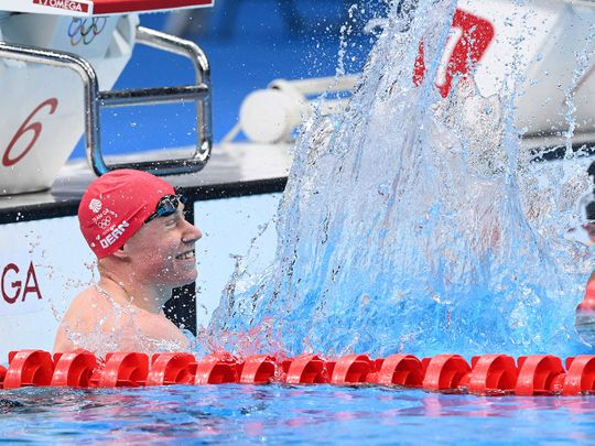 Britain's Tom Dean celebrates after winning the final of the men's 200m freestyle