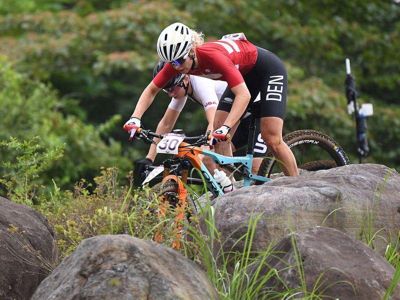 Denmark's Malene Degn rides in the mountain bike women's cross-country event