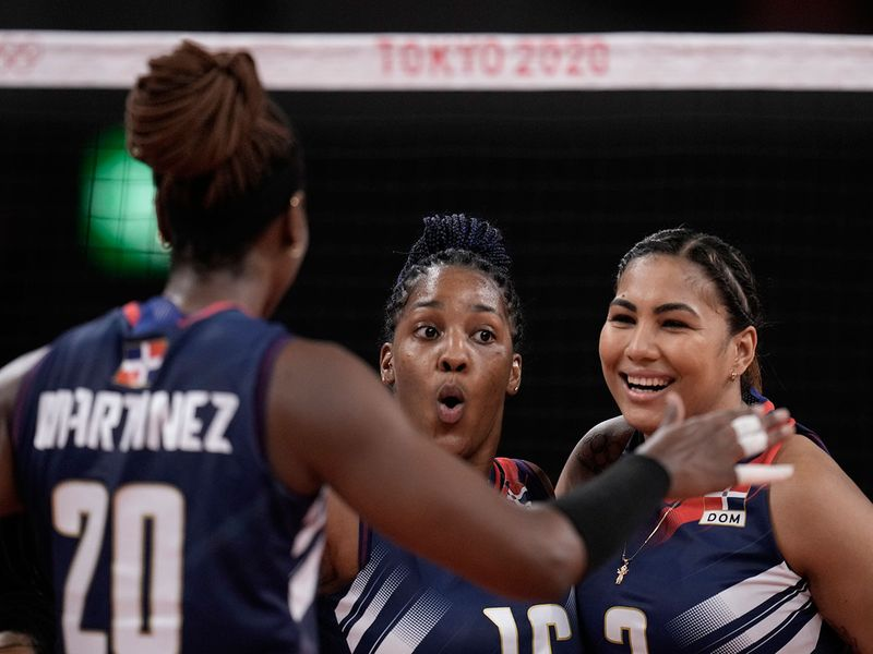 Dominican Republic's Yonkaira Paola Pena Isabel, centre, celebrates with teammates, during a match against Brazil