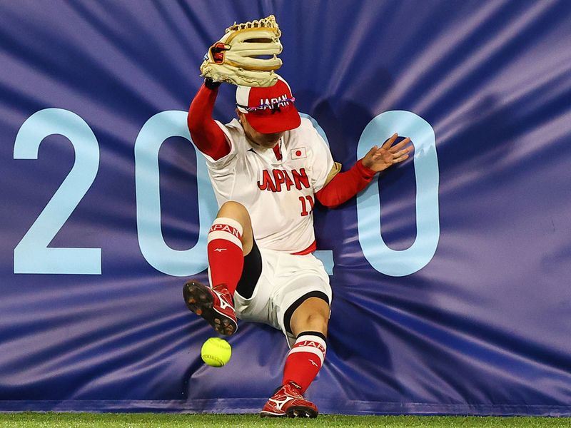 Eri Yamada of Japan takes a hit against United States in the softball