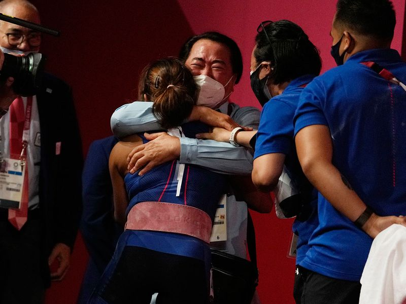 Hidilyn Diaz of Philippines celebrates winning the women's 55kg weightlifting event, at the Tokyo 2020 Olympic Games