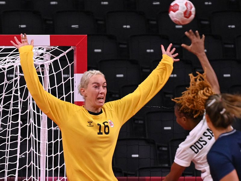 Norway's goalkeeper Katrine Lunde tries to stop a shot against Angola in the handball competition