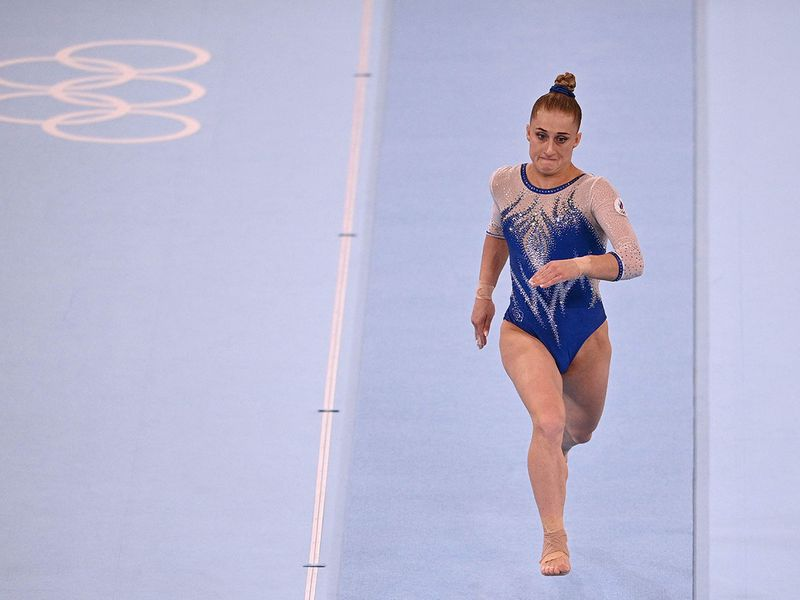 Russia's Liliia Akhaimova gets up to speed in the floor event of the artistic gymnastics women's team final
