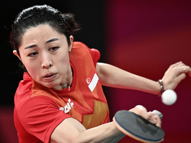 Singapore's Yu Meng Yu competes against USA's Juan Liu in the women's singles table tennis