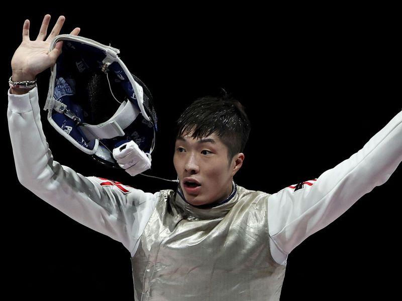 Cheung Ka Long of Hong Kong celebrates after winning gold