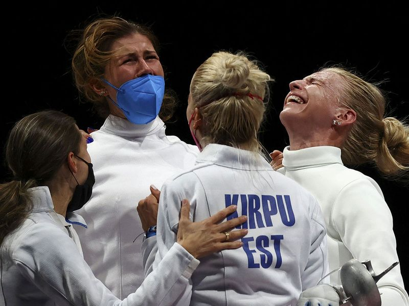 Estonia's Katrina Lehis celebrates with her teammates after winning against South Korea's Choi Injeong  in the women's team epee gold medal bout
