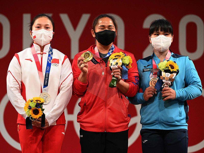 Hidilyn Diaz edged out China's Liao Qiuyun and Kazakhstan's Zulfiya Chinshanlo in Tokyo.