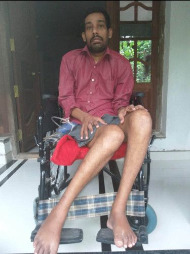 Sijish needs the help of two people to be shifted on a wheelchair-1627480583811