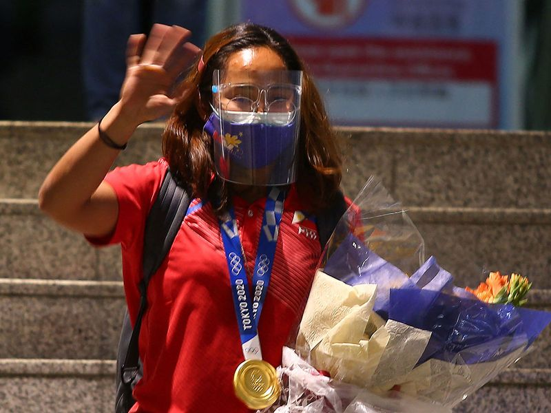 Euphoric Philippines, rewards greet Olympic gold winner Hidilyn Diaz home