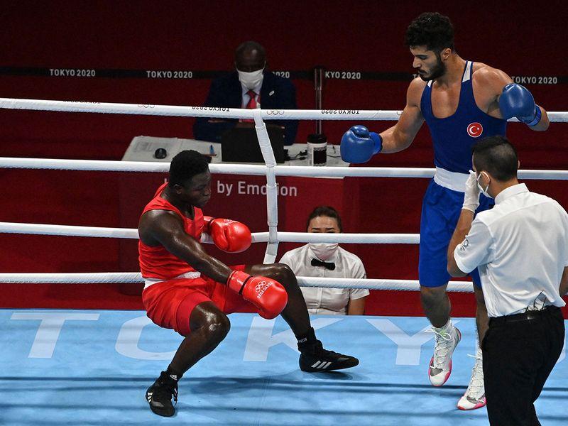 Ghana's Shakul Samed is sent down by Turkey's Bayram Malkan in the boxing