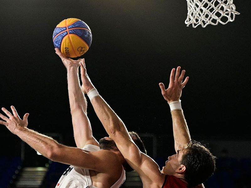 Serbia's Dejan Majstorovic fights for the ball with Belgium's Rafael Bogaerts during the men's 3x3 basketball match