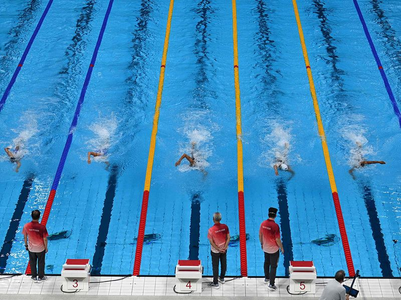 Swimmers compete in the women's 100m freestyle