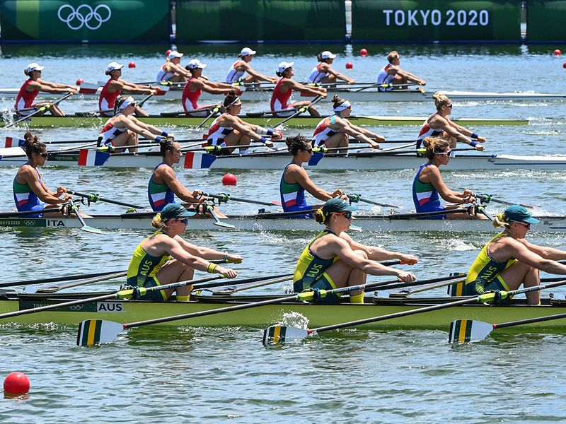 Teams ready for the women's quadruple sculls rowing heats at the Sea Forest Waterway