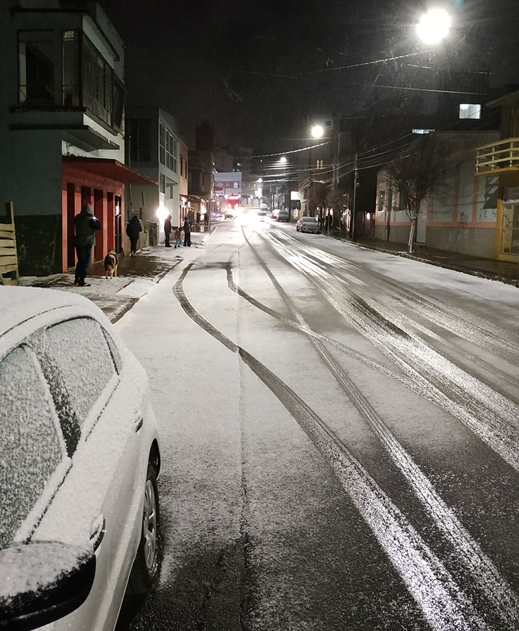 General view of a street covered in snow in Vacaria, Rio Grande do Sul, Brazil.