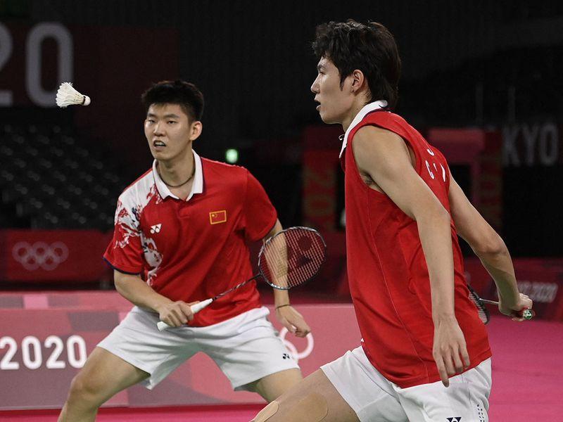 China's Li Junhui and Liu Yuchen in their men's doubles badminton final match against Taiwan's Wang Chi-lin and Lee Yang