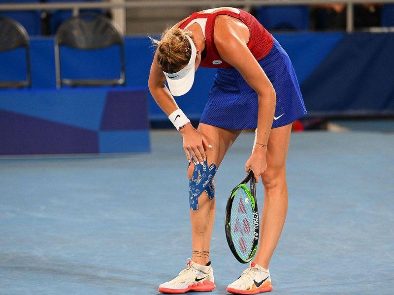 Czech Republic's Marketa Vondrousova takes a breather against Switzerland's Belinda Bencic in the women's tennis