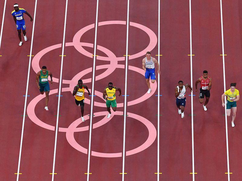 Ghana's Benjamin Azamati-Kwaku, Jamaica's Yohan Blake and Australia's Rohan Browning lead the way in their 100m heat