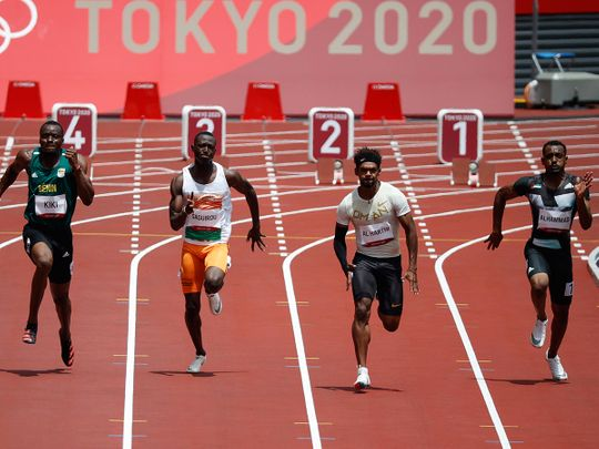 The UAE's Mohammed Al Hammadi, right, in action in the 100m