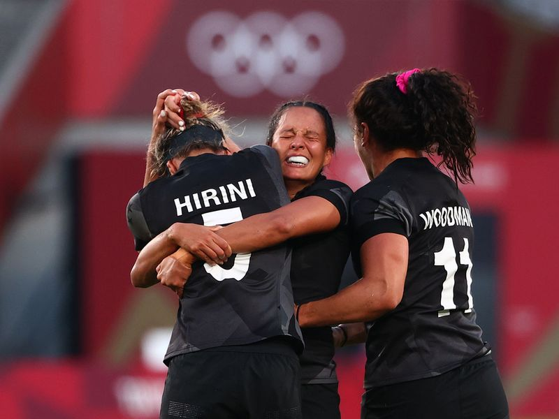 Tyla Nathan-Wong, Sarah Hirini and Portia Woodman of New Zealand celebrate the win over France. REUTERS/Stoyan Nenov