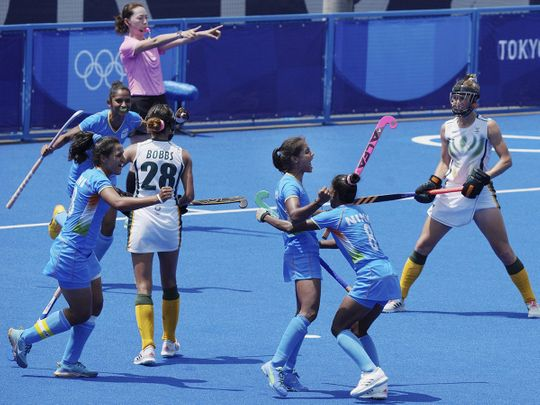 India's Vandana Katariya celebrates with teammates after scoring her hat-trick goal against South Africa