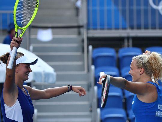 Katerina Siniakova and Barbora Krejcikova of Czech Republic celebrate after winning their gold medal match against Viktorija Golubic and Belinda Bencic of Switzerland