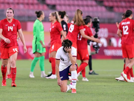 Carli Lloyd of the United States looks dejected after the loss to Canada