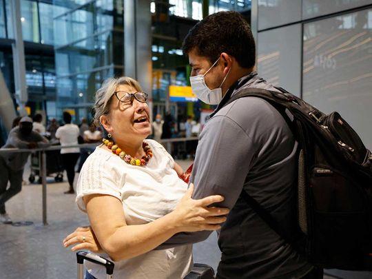 Heathrow arrival mother son airport England covid