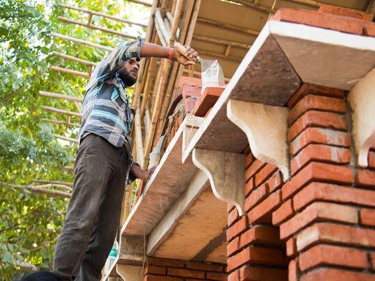Man building house bricks