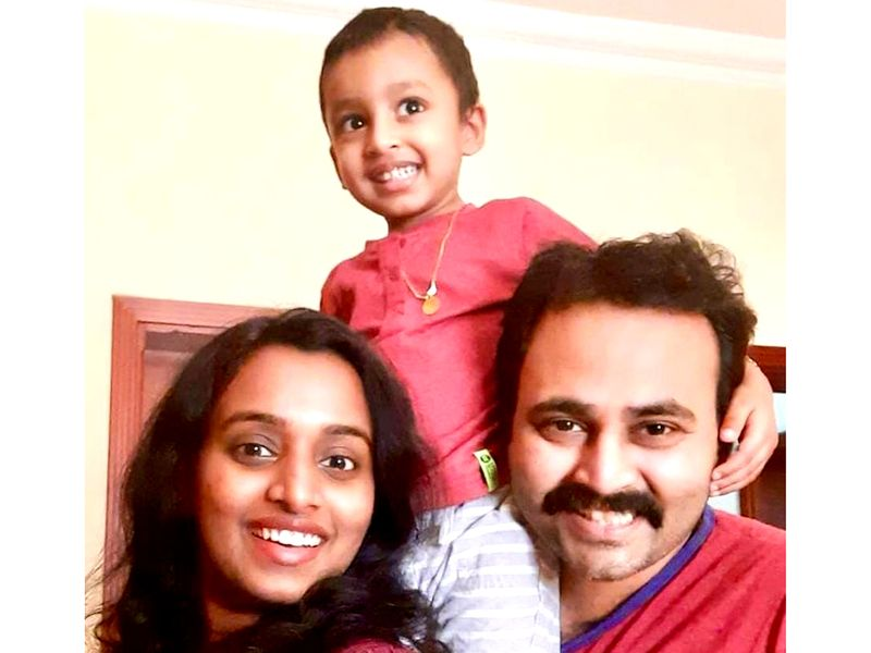 Sanoop Sunil (right) with his wife and kid.