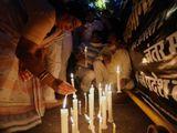 india activists rape march candles