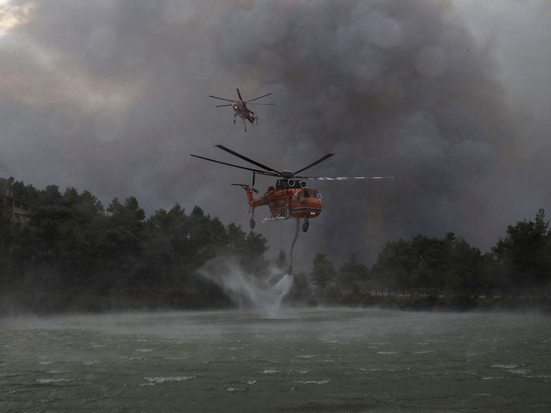 2021-08-06T084656Z_1577327504_RC2HZO9DJVS1_RTRMADP_3_EUROPE-WEATHER-GREECE-WILDFIRES