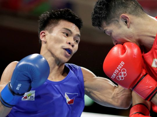 Carlo Paalam of the Philippines in action against Ryomei Tanaka of Japan.