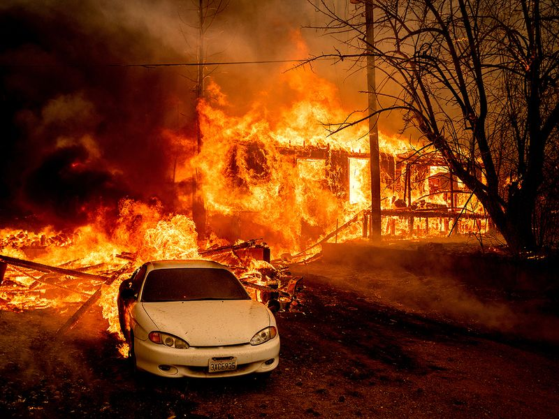 Flames from the Dixie Fire consume a home on Highway 89 south of Greenville, in Plumas County, California.