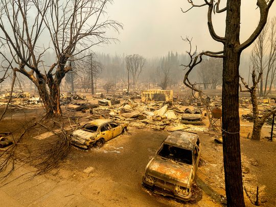 This photo shows cars and homes destroyed by the Dixie Fire line central Greenville, in Plumas County, California.