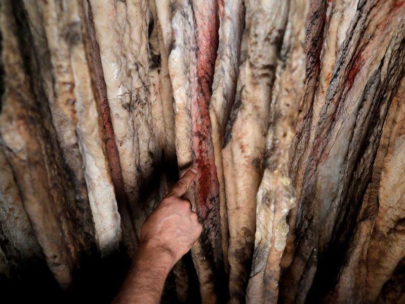 stalagmites by Neanderthals cave red ocher