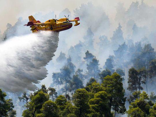 wildfire Greece village plane