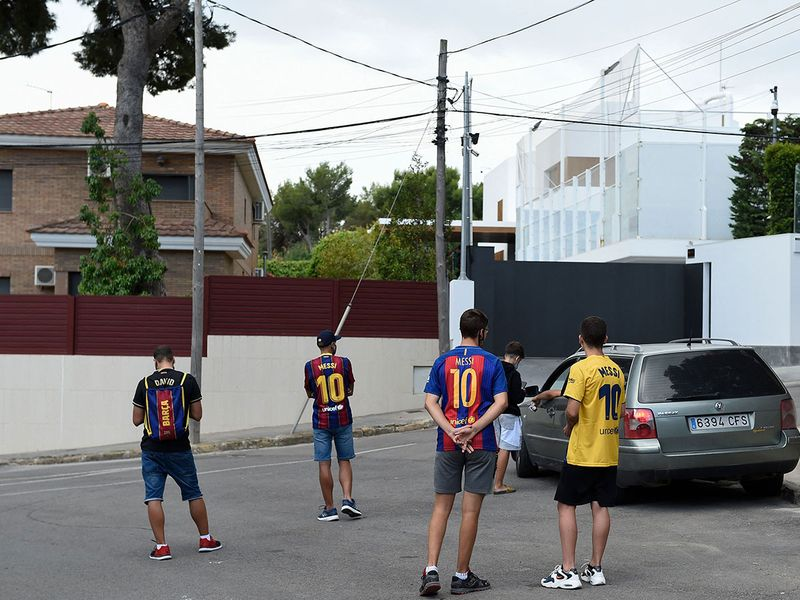 Fans wait in vain for an appearance of Lionel Messi outside his house in Barcelona