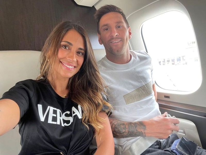 Argentine soccer player Lionel Messi and his wife Antonela Roccuzzo pose inside their private jet en route to Paris.