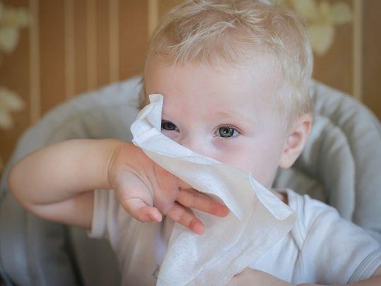 Child eating tissue