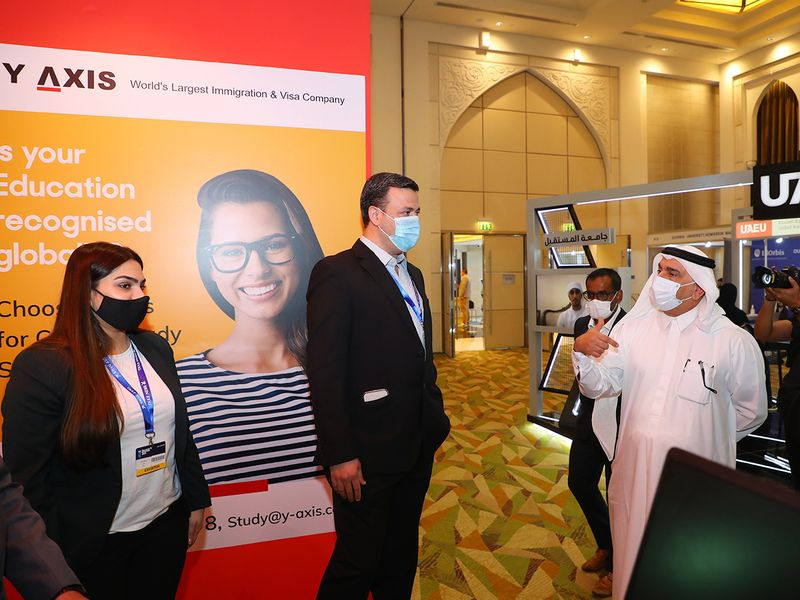Clint Khan (centre), Director at Y-Axis Middle East, with Gulf News' CEO and Editor-in-Chief Abdul Hamid (right) at Gulf News Edufair 2021.