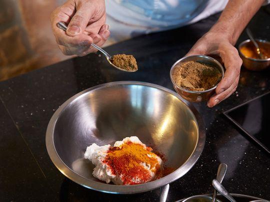 Marinating chicken tikka