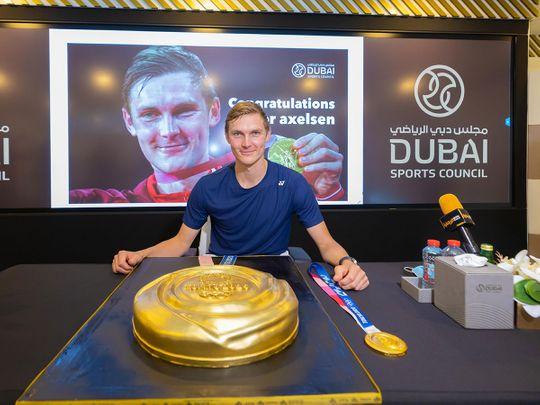 Viktor Axelsen celebrates at Dubai Sports Council with a giant gold medal cake